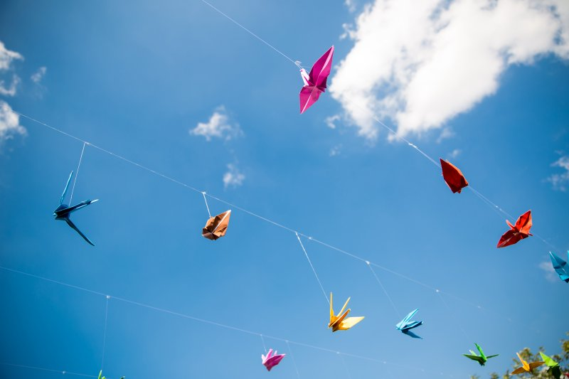 Origami cranes on blue sky